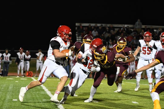 Yankton's Caid Koletzky (3) rushes for a first down in action against Harrisburg on Thursday night in Harrisburg. The Bucks won 28-26 in the final regular season game.