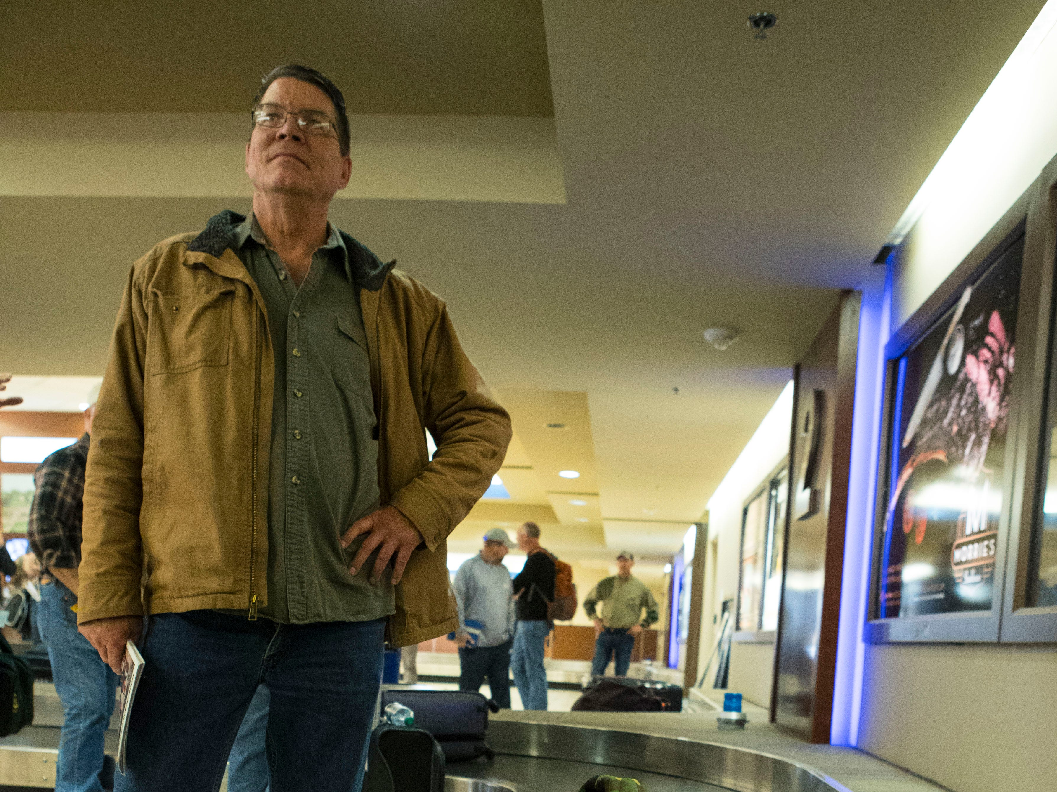 Pheasant hunter waits for his luggage at Sioux Falls Regional Airport Friday, Oct. 19, 2018.