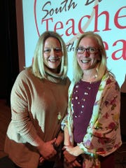Erica Boomsma, left, stands with Interim Education Secretary Mary Stadick Smith after being named the 2019 Teacher of the Year.