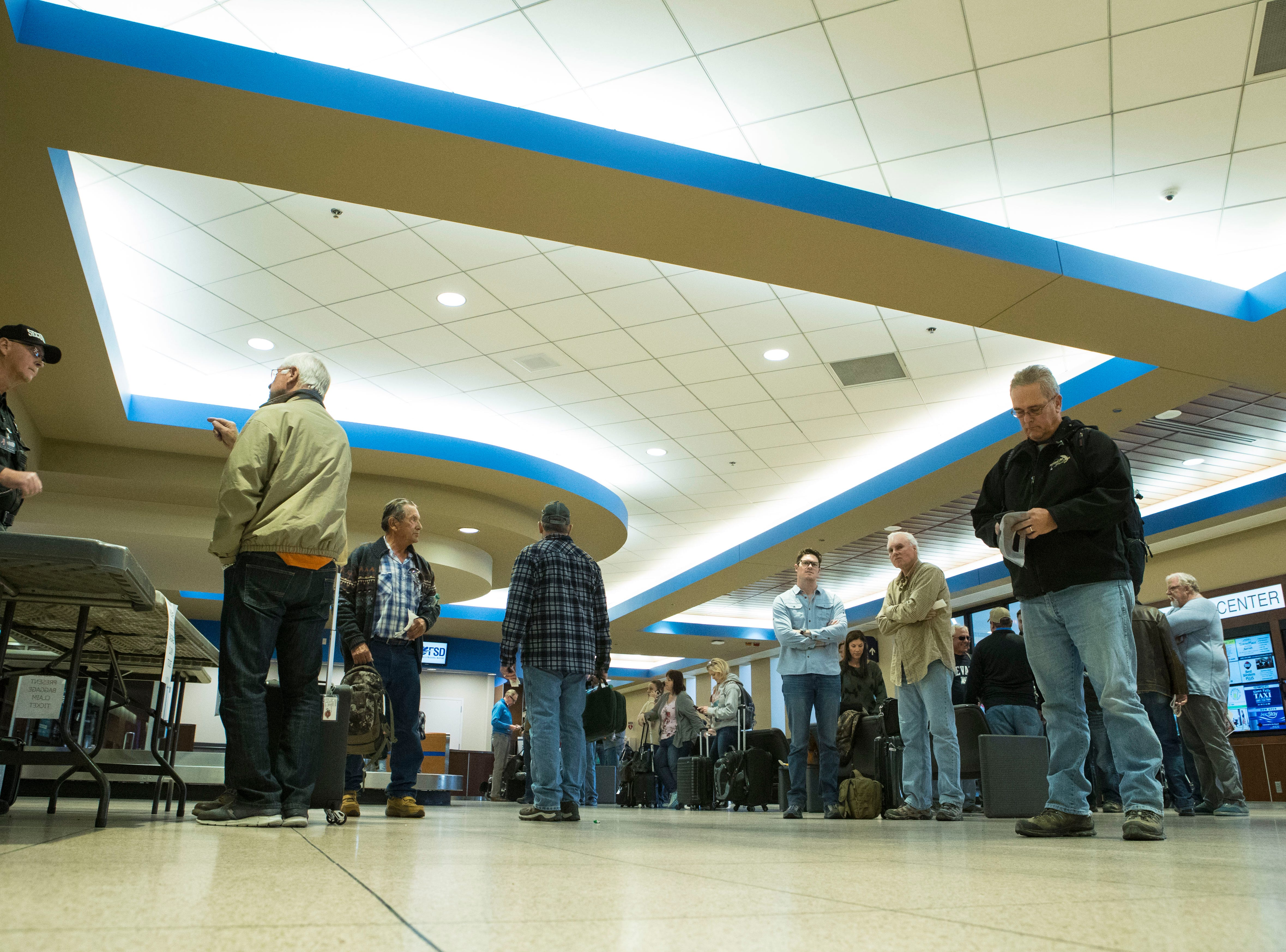 Pheasant hunters wait for their luggage at Sioux Falls Regional Airport Friday, Oct. 19, 2018.