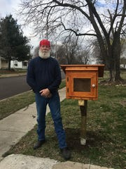 Eugene George built a Little Free Library for his cousin Jackie Johnson, who'd wanted one for years.