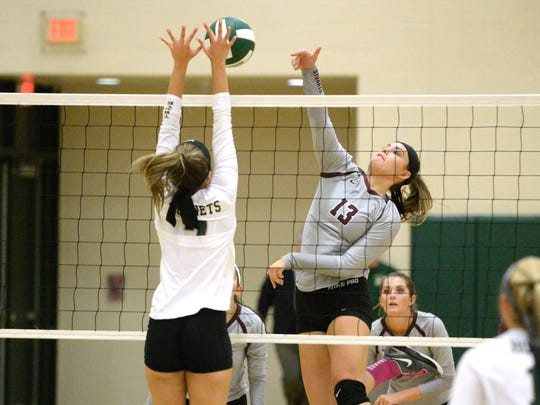 Stuarts Draft's Madie Varner (13) tries to hit past Wilson Memorial's Olivia Bower Thursday in a Shenandoah District volleyball match.
