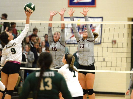 Stuarts Draft's Hadley May (10) and Madie Varner (13) attempt to block Wilson Memorial's Carlee Hatfield Thursday night.