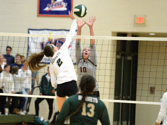 Wilson Memorial's Cassidy Davis (2) tries to hit over the block of Stuarts Draft's Hadley May (10) Thursday in a Shenandoah District volleyball match. Wilson won in 3.