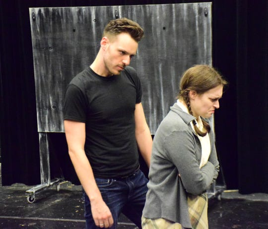"""Dustin Roadcap as """"Billy Nolan"""" and Cori McDaniel as """"Carrie White"""" rehearse a scene from """"Carrie: The Musical"""" on Thursday, October 18, 2018, at Blue Ridge Community College in Weyers Cave, Va. The show, directed by Roadcap, runs from Oct. 25 through 28 at the Fine Arts Center Theatre."""