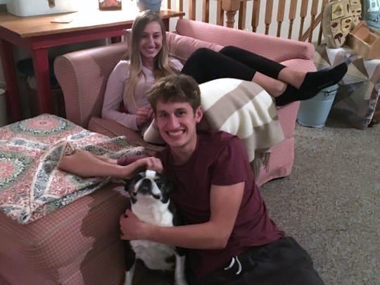 Jacob Jones sits with his dog, Marley and older sister, Madison, in the family's Weyers Cave home.