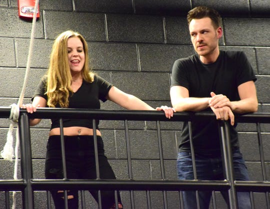 """Bri Pursley as """"Chris Hargensen"""" and Dustin Roadcap as """"Billy Nolan"""" rehearse a scene from """"Carrie: The Musical"""" on Thursday, October 18, 2018, at Blue Ridge Community College in Weyers Cave, Va. The show, directed by Roadcap, runs from Oct. 25 through 28 at the Fine Arts Center Theatre."""