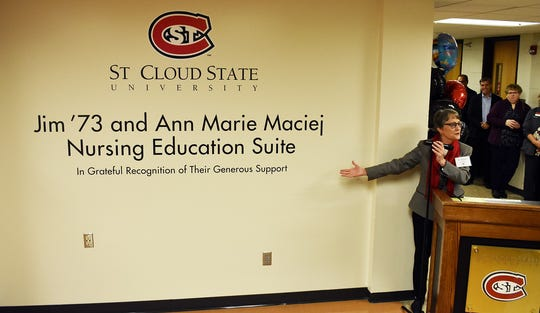 """St. Cloud State University President Robbyn Wacker unveils the newly-named Department of Nursing wing in Brown Hall as the """"Jim '73 and Ann Marie Maciej Nursing Education Suite."""""""