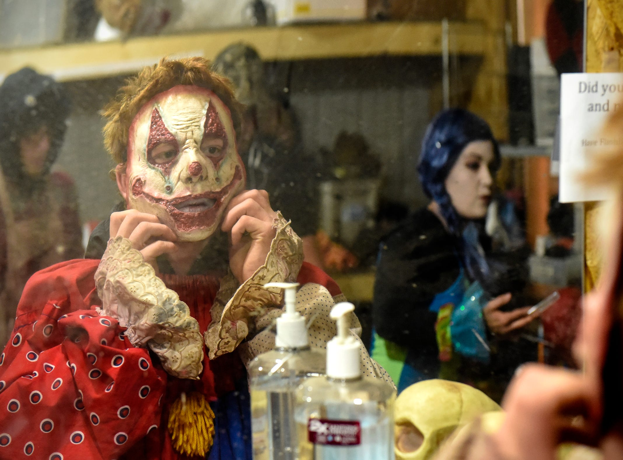 Justin Strassburg straightens his mask while preparing for the haunt to begin Thursday, Oct. 18, at Molitor's Haunted Acres in Sauk Rapids.