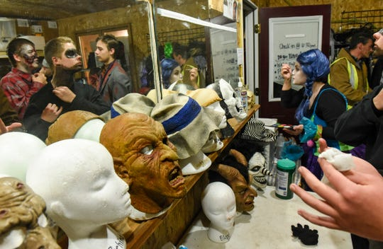 Performers get into costume Thursday, Oct. 18, at Molitor's Haunted Acres in Sauk Rapids.