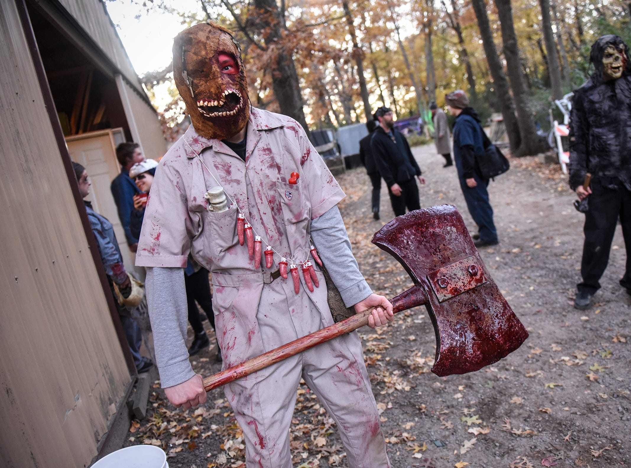 Actors prepare for their haunting performances Thursday, Oct. 18, at Molitor's Haunted Acres in Sauk Rapids.