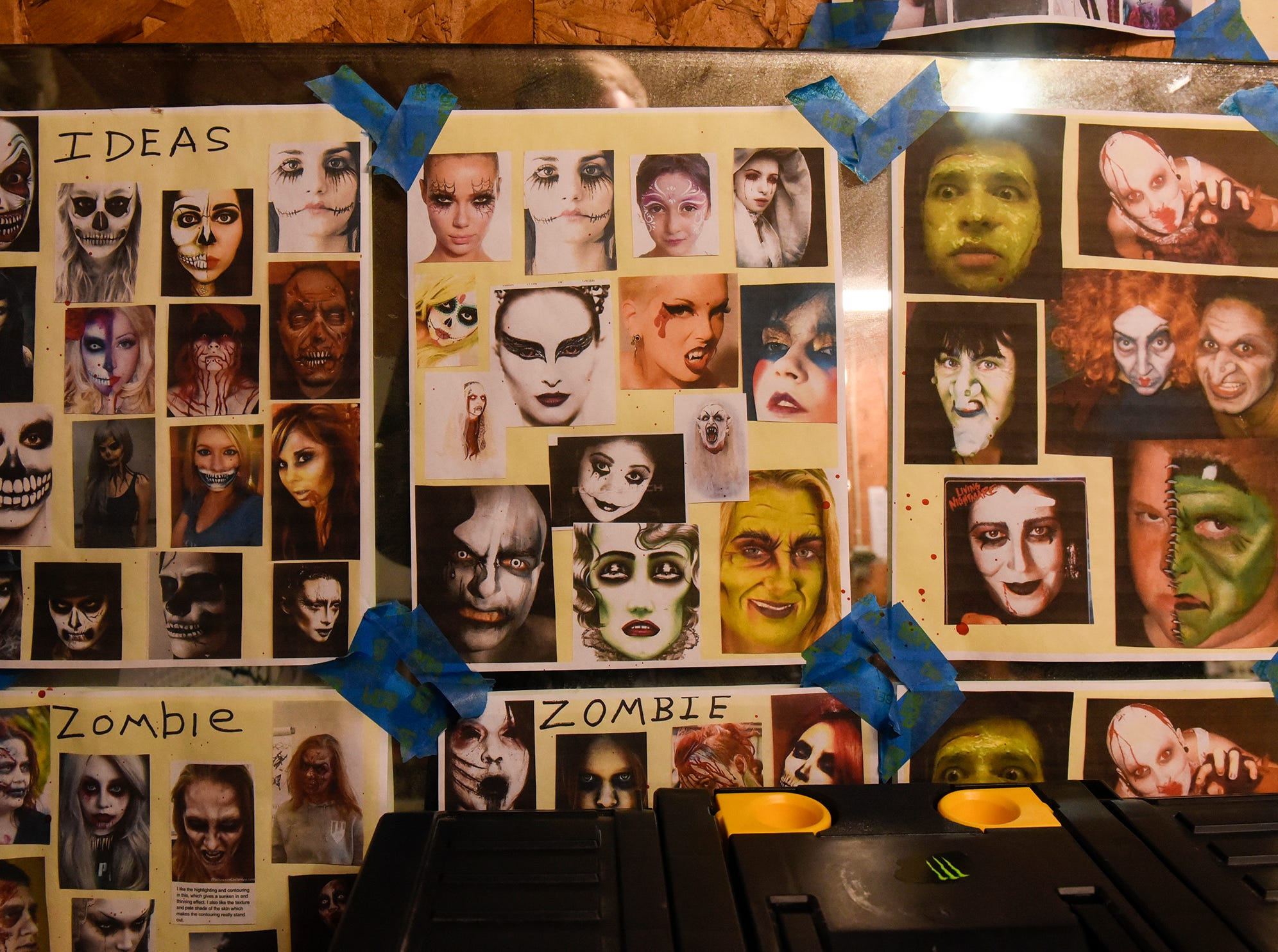Makeup ideas line the walls of the makeup room Thursday, Oct. 18, at Molitor's Haunted Acres in Sauk Rapids.