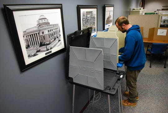 Matt Baker, St. Joseph, takes advantage of early voting and completes his ballot Friday, Oct. 19, at the Stearns County Administration Center at 705 Courthouse Square in St Cloud.