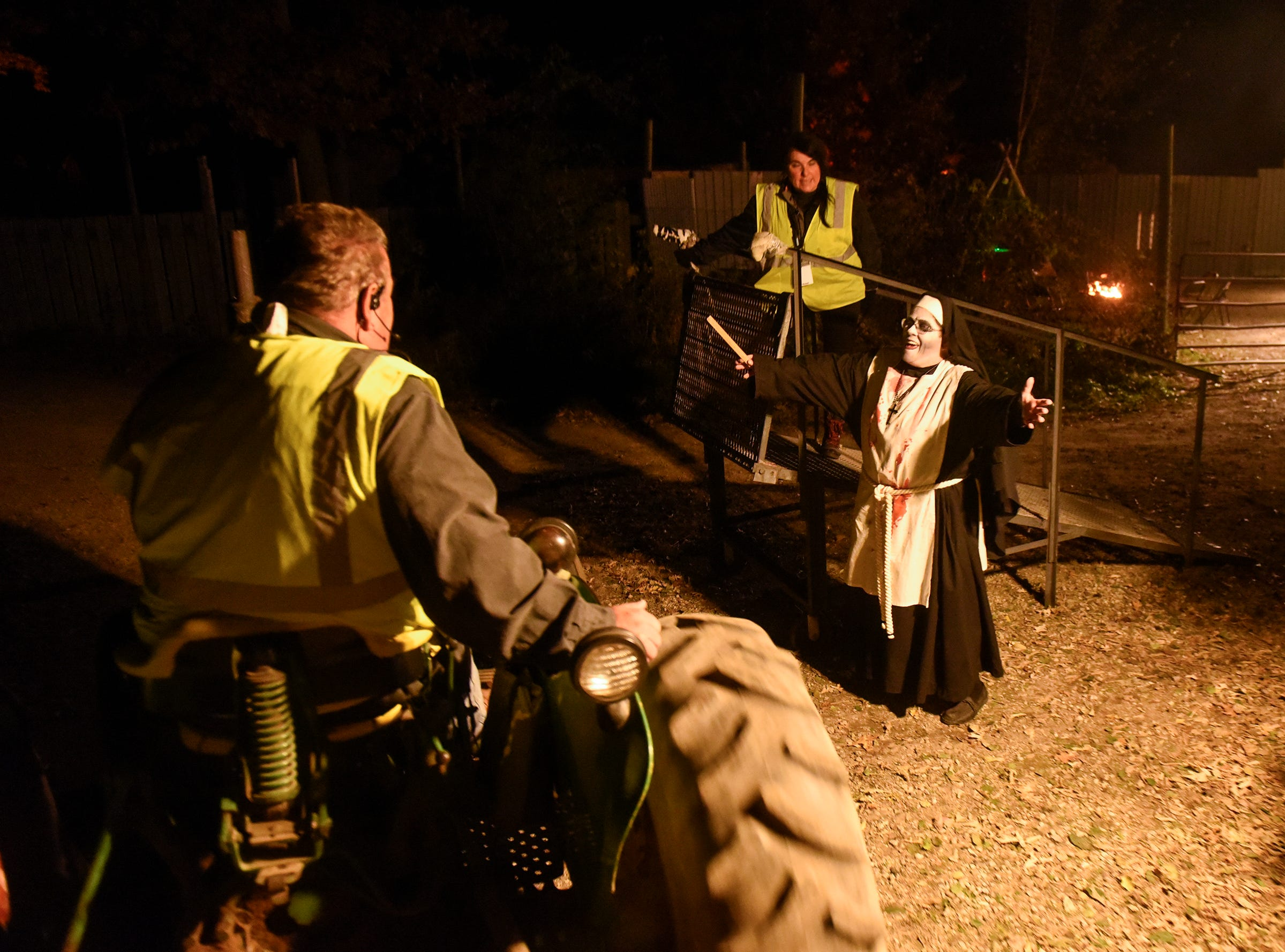 Visitors are dropped off after their hayride through the haunted woods Thursday, Oct. 18, at Molitor's Haunted Acres in Sauk Rapids.