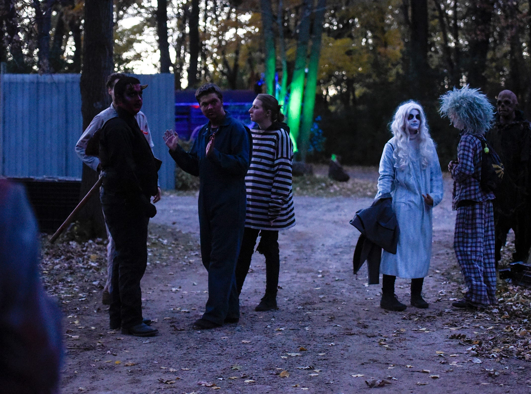 Characters gather before taking their places to start the evening's haunt Thursday, Oct. 18, at Molitor's Haunted Acres in Sauk Rapids.