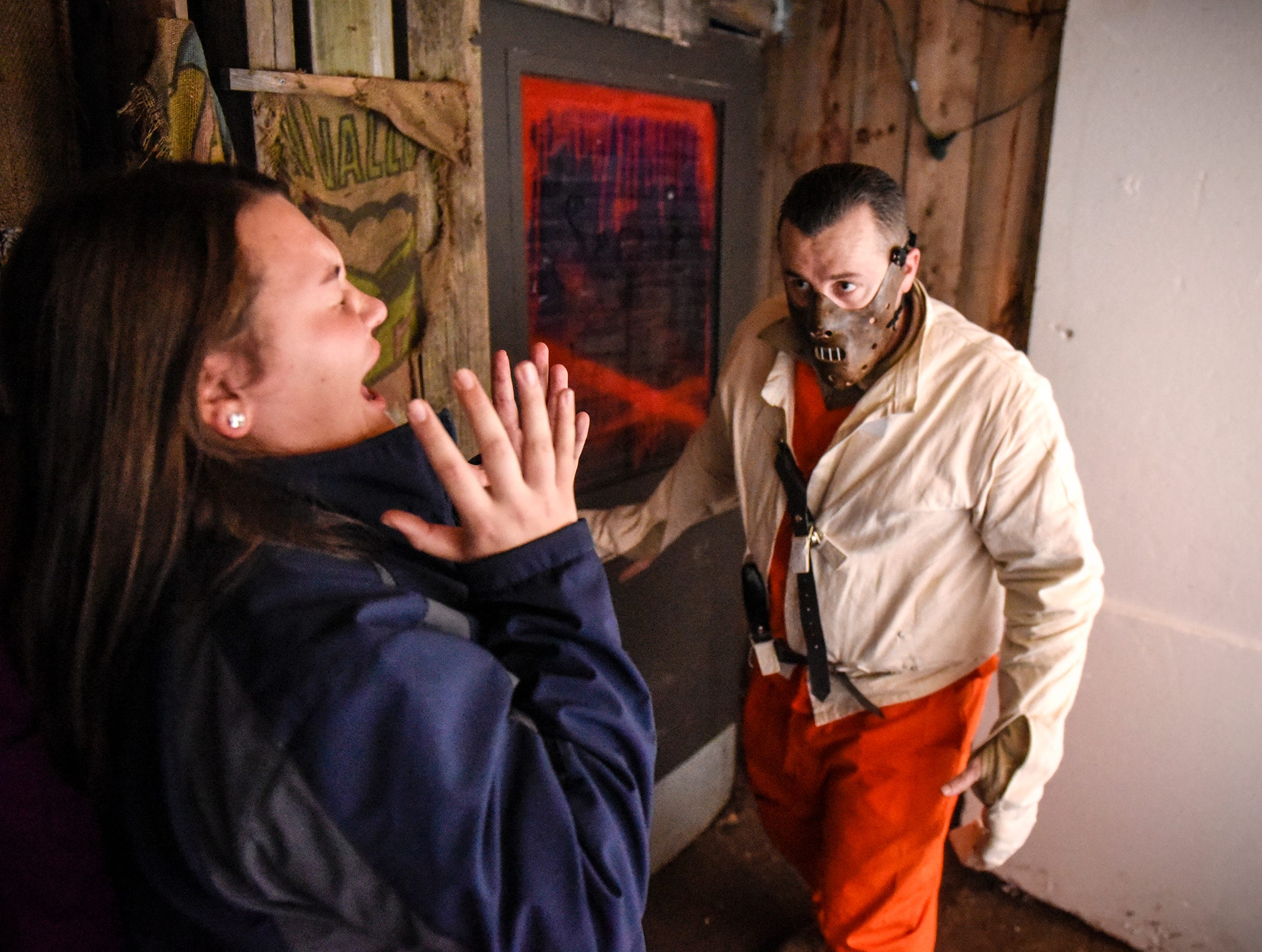 Guests react to a character Thursday, Oct. 18, at Molitor's Haunted Acres in Sauk Rapids.
