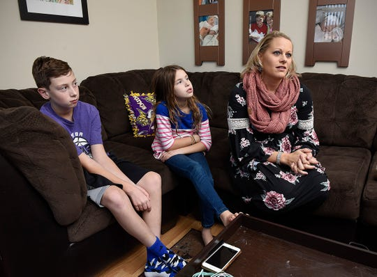 Stephanie Cone, with her children Calen, 11, and Cadie, 8, talk about short time they spent with Clara after she was born. Thursday, Oct. 18, in Sartell.