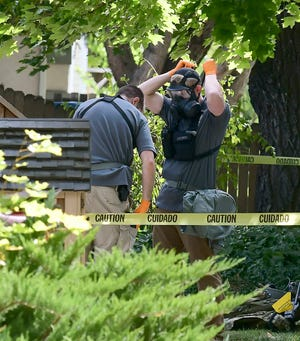 FILE - In this Oct. 3, 2018, file photo, law enforcement officers search a house where William Clyde Allen III,  a man suspected of mailing ricin to the Pentagon and President Donald Trump was taken into custody in Logan, Utah. An indictment unsealed Thursday, Oct. 18 says Allen mailed envelopes to the CIA director and the Air Force secretary as well as Trump and other top officials. Allen pleaded not guilty to seven charges, including threatening to use a biological toxin as a weapon. (Eli Lucero /The Herald Journal via AP, File)