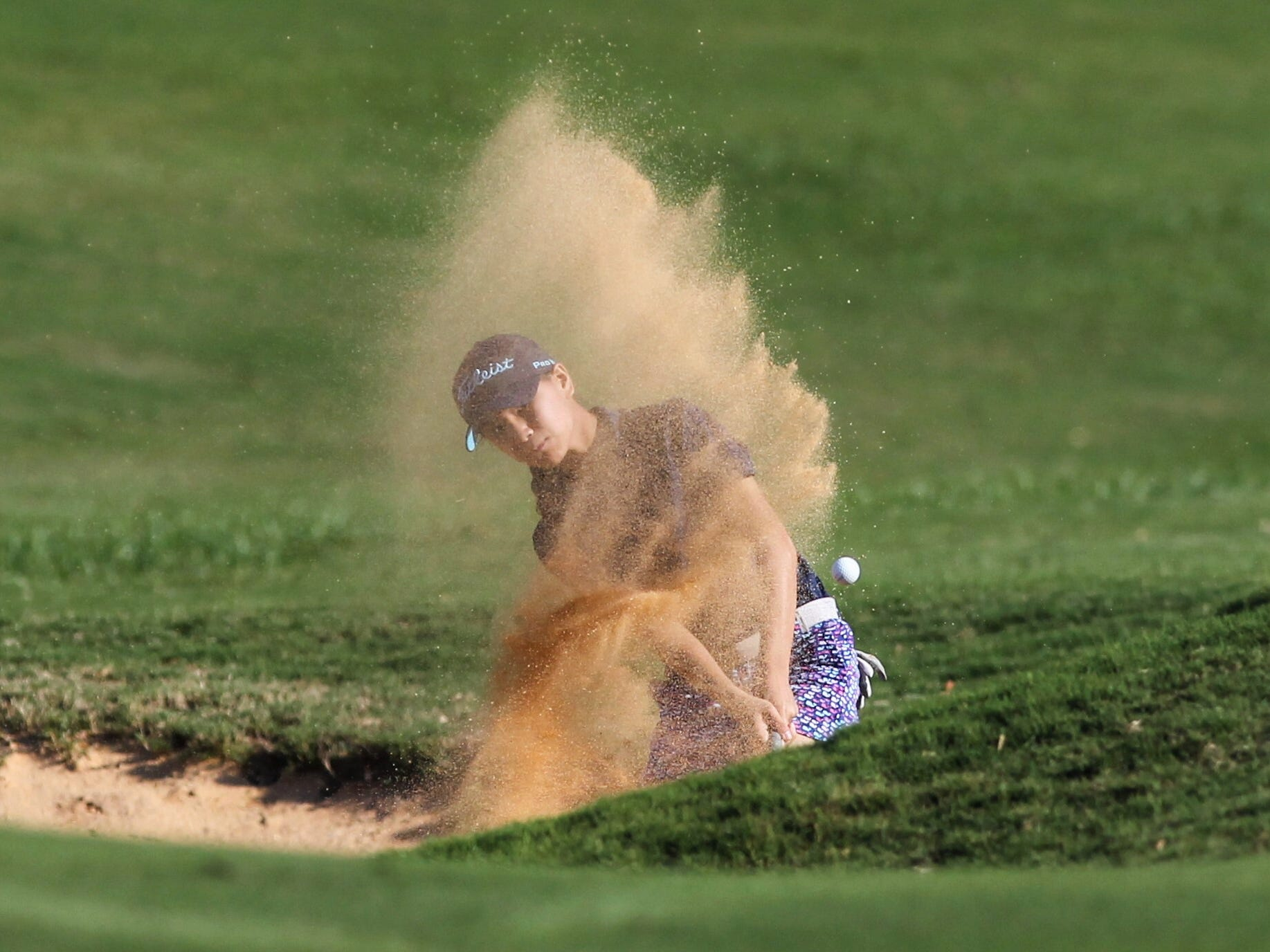 Community Christian's Tynley Cotton chips out of a bunker during the District 1-1A boys and girls golf tournaments at Southwood Golf Club.