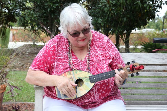 Members of the Ukulele therapy group play some tunes at the TMH Cancer Center on Friday, Oct. 19, 2018.