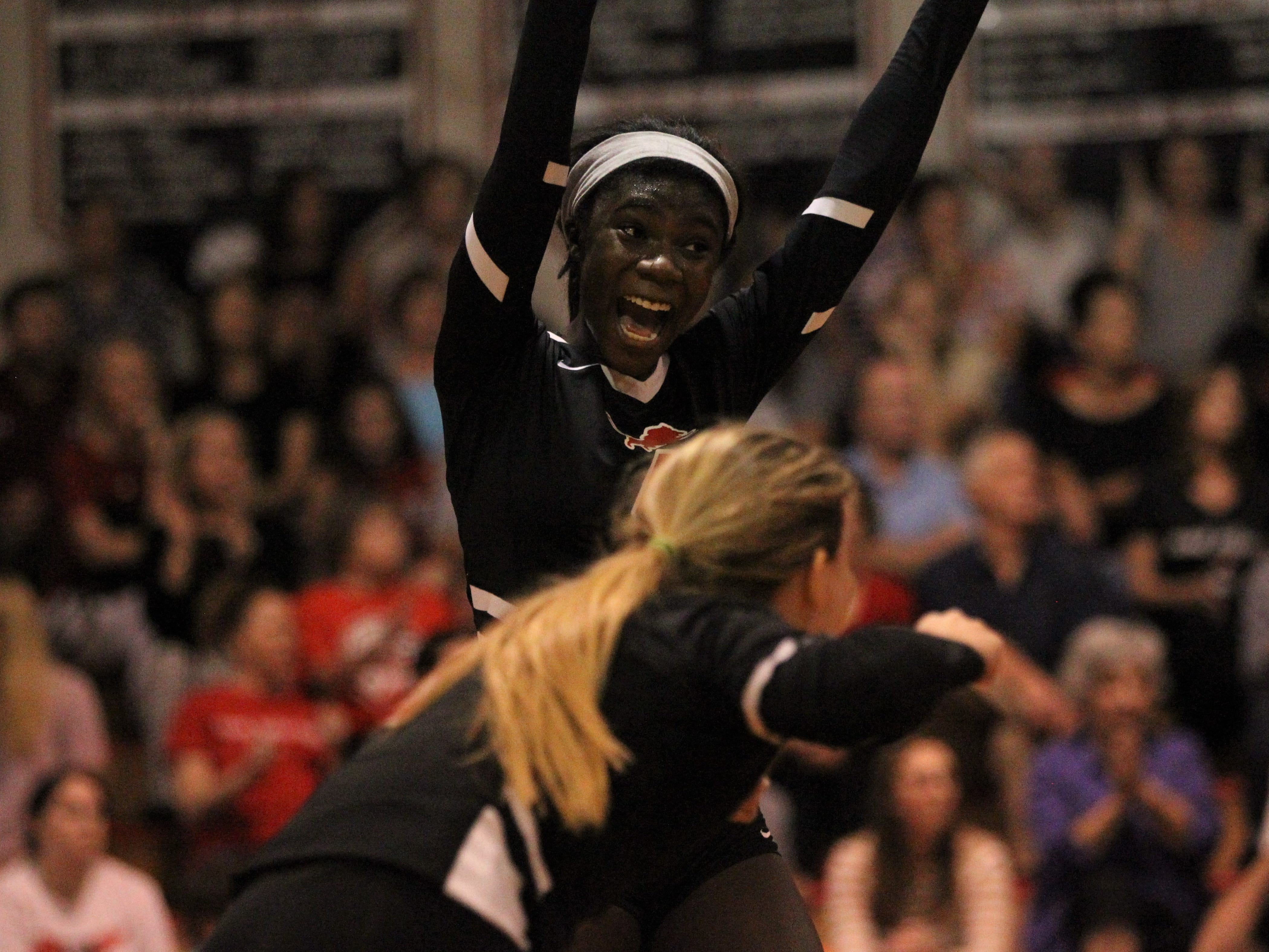 Leon junior Shania Cromartie celebrates a point during a District 2-8A championship match.
