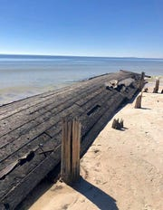 Ships that washed ashore on Dog Island during the 1899 Carrabelle Hurricane were unearthed completely by Hurricane Michael's vicious storm surge last week.