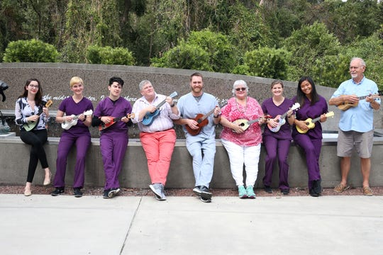 The members of the Ukulele and Pet Therapy Group pose for a photograph at the  TMH Cancer Center on Friday, Oct. 19, 2018.