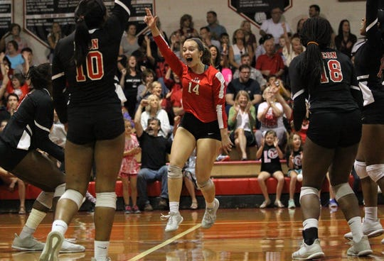 Leon junior Katrin Fredrickson celebrates a point with her teammates during a District 2-8A championship match.