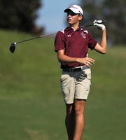 Madison County's Payton Davis watches a tee shot during the District 1-1A boys and girls golf tournaments at Southwood Golf Club.