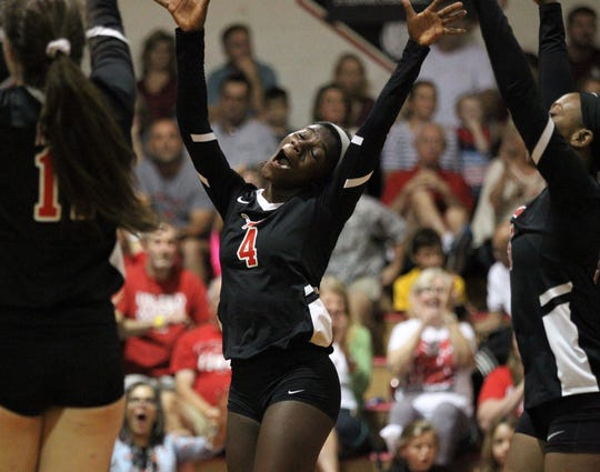 Leon junior Shania Cromartie celebrates a point with teammates during a District 2-8A championship match.