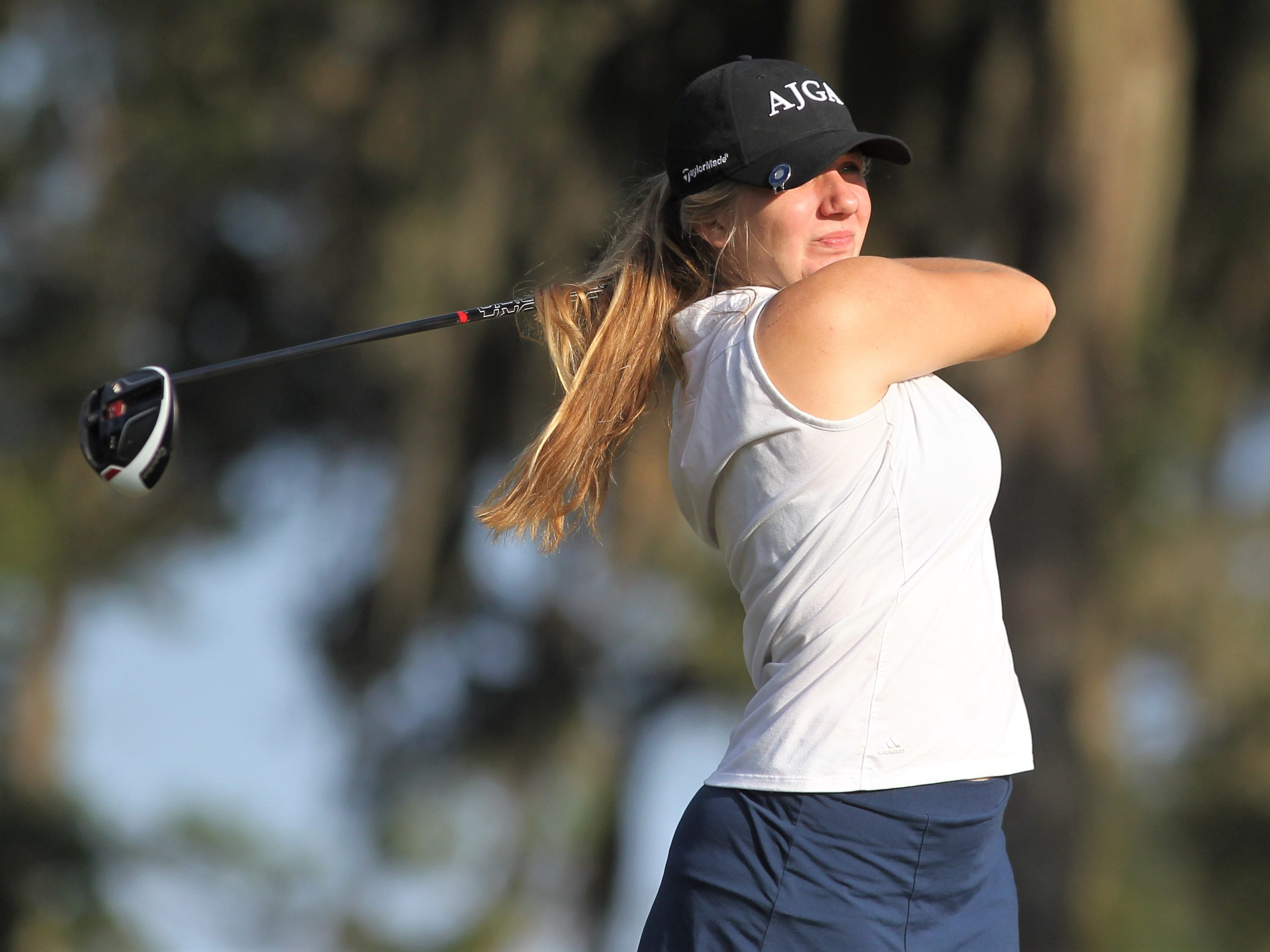 Franklin County's Melanie Collins watches a drive during the District 1-1A boys and girls golf tournaments at Southwood Golf Club.