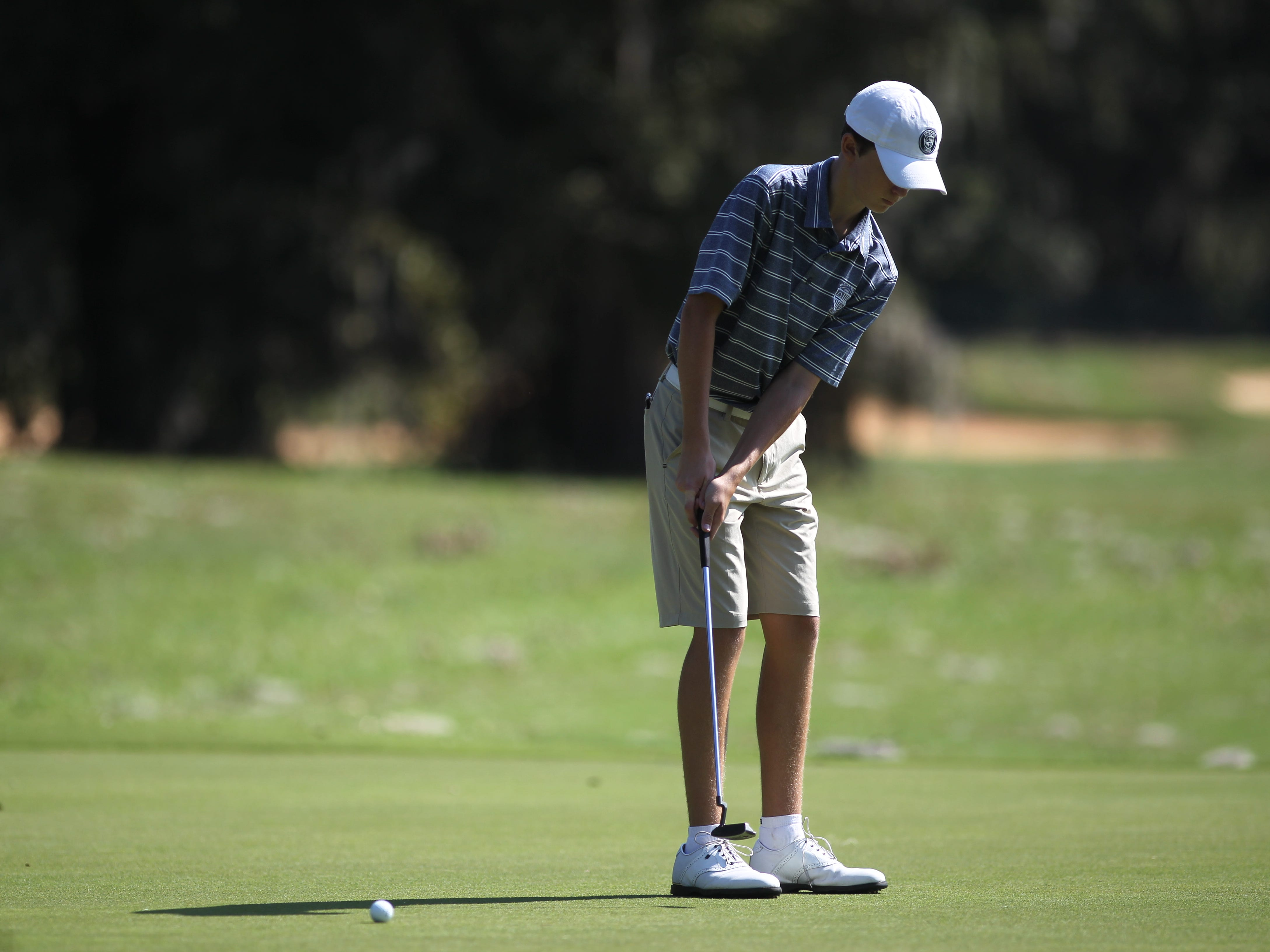 Maclay's Patrick McCann plays during the District 1-1A boys and girls golf tournaments at Southwood Golf Club.
