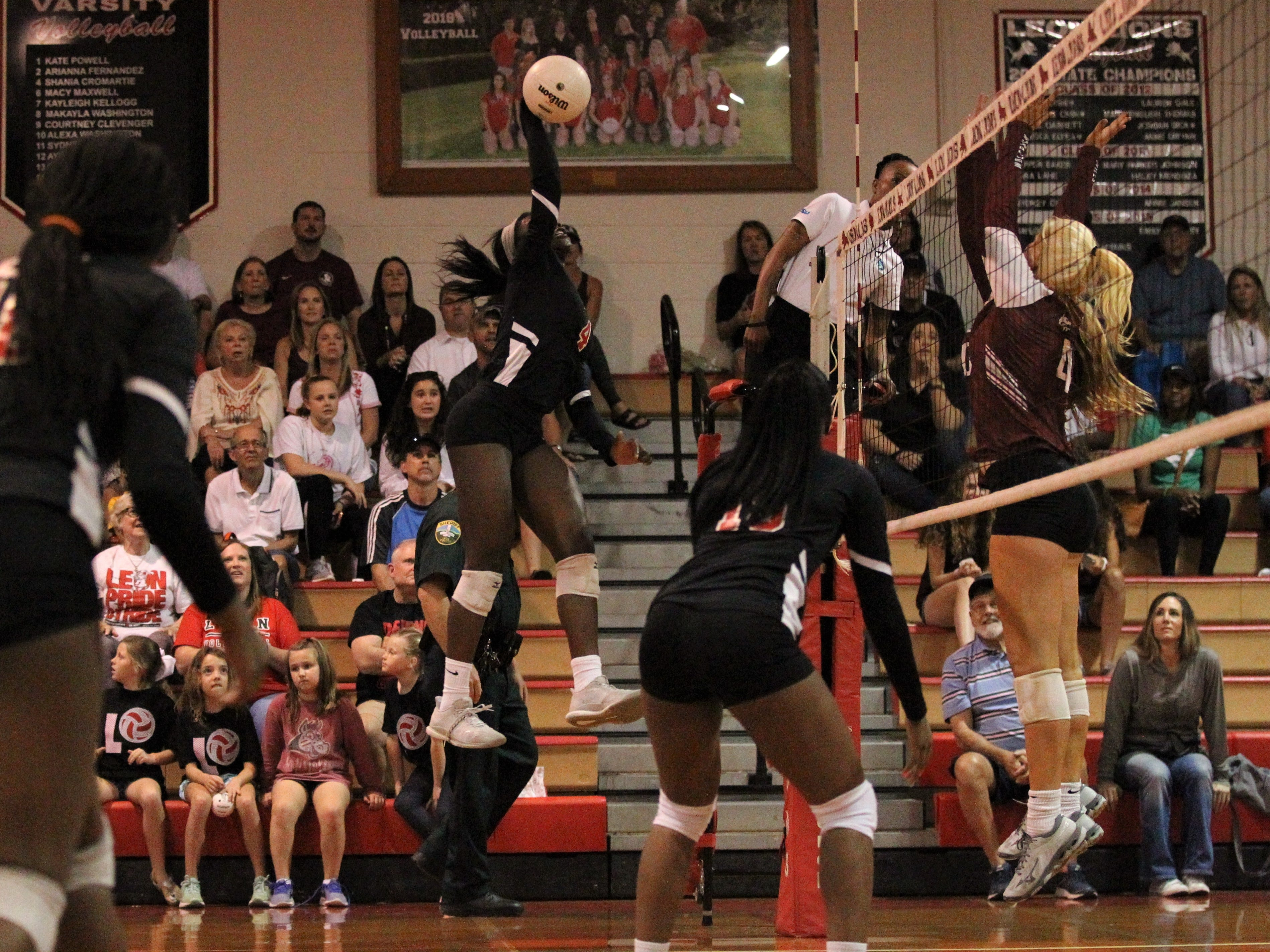 Leon's Shania Cromartie goes for a kill during a District 2-8A championship match.