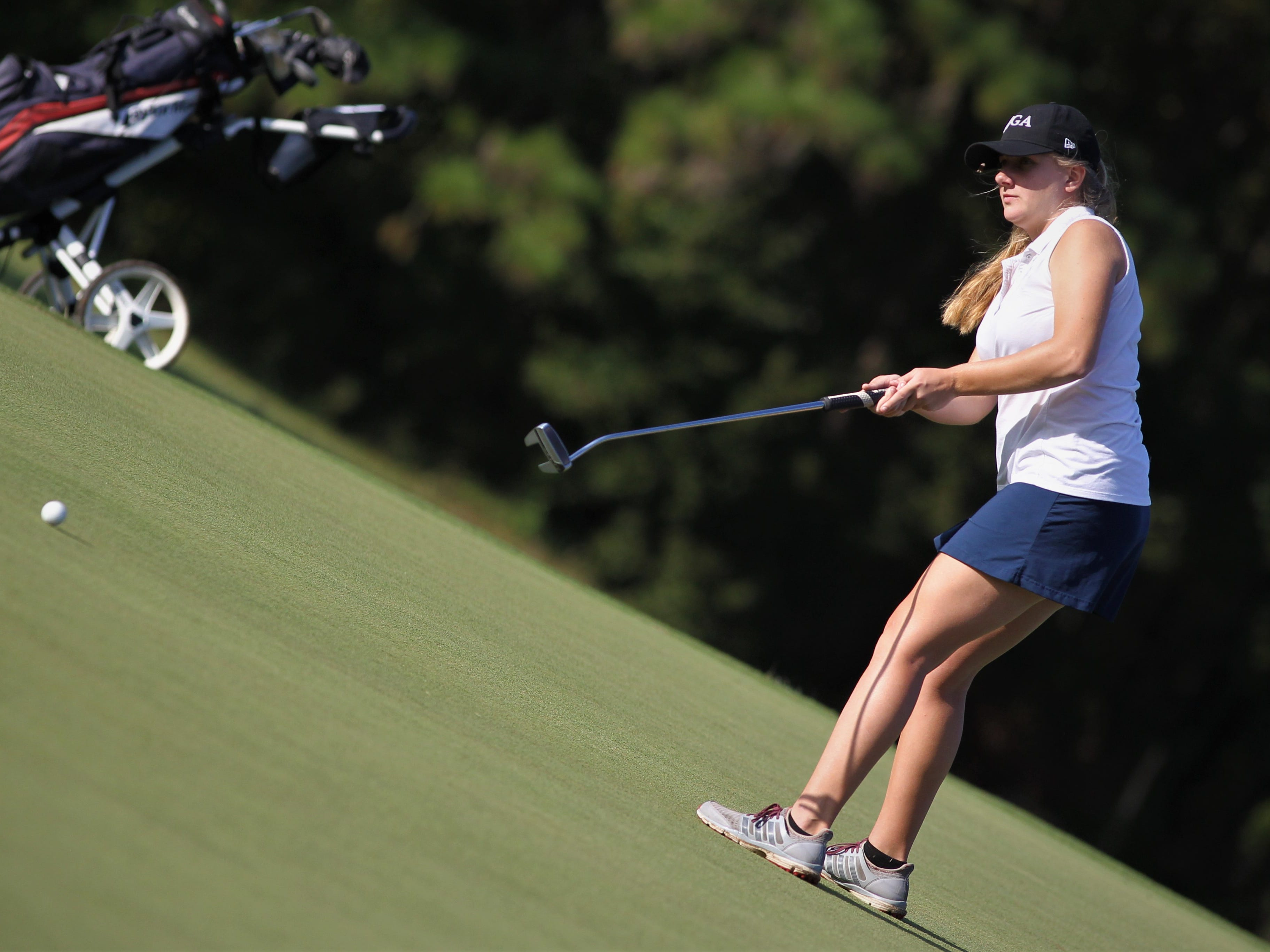 Franklin County's Melanie Collins putts during the District 1-1A boys and girls golf tournaments at Southwood Golf Club.