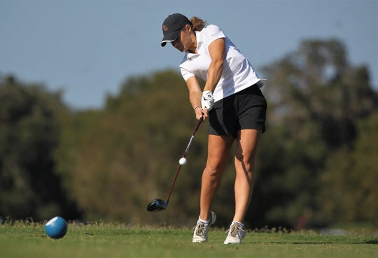 Florida High's Savannah Bonn tees off during the District 1-1A boys and girls golf tournaments at Southwood Golf Club.