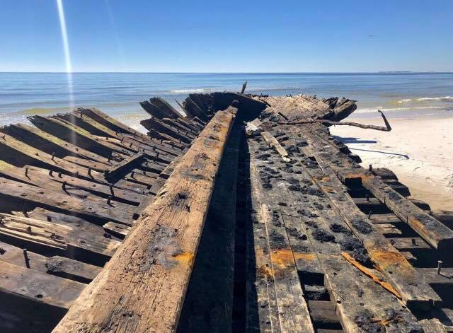 Ships that washed ashore on Dog Island during the 1899 Carrabelle Hurricane wereunearthed completely by Hurricane Michael's vicious storm surge last week.
