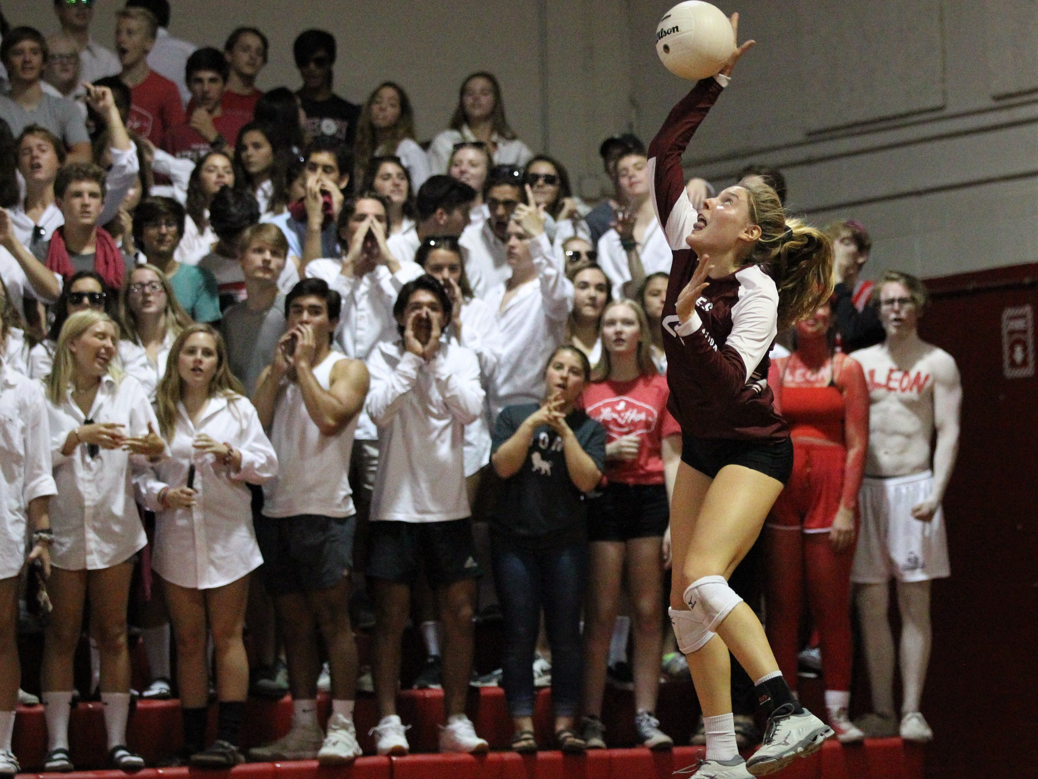 Chiles senior Kelsey Mead serves in front of the Leon student body during a District 2-8A championship game.