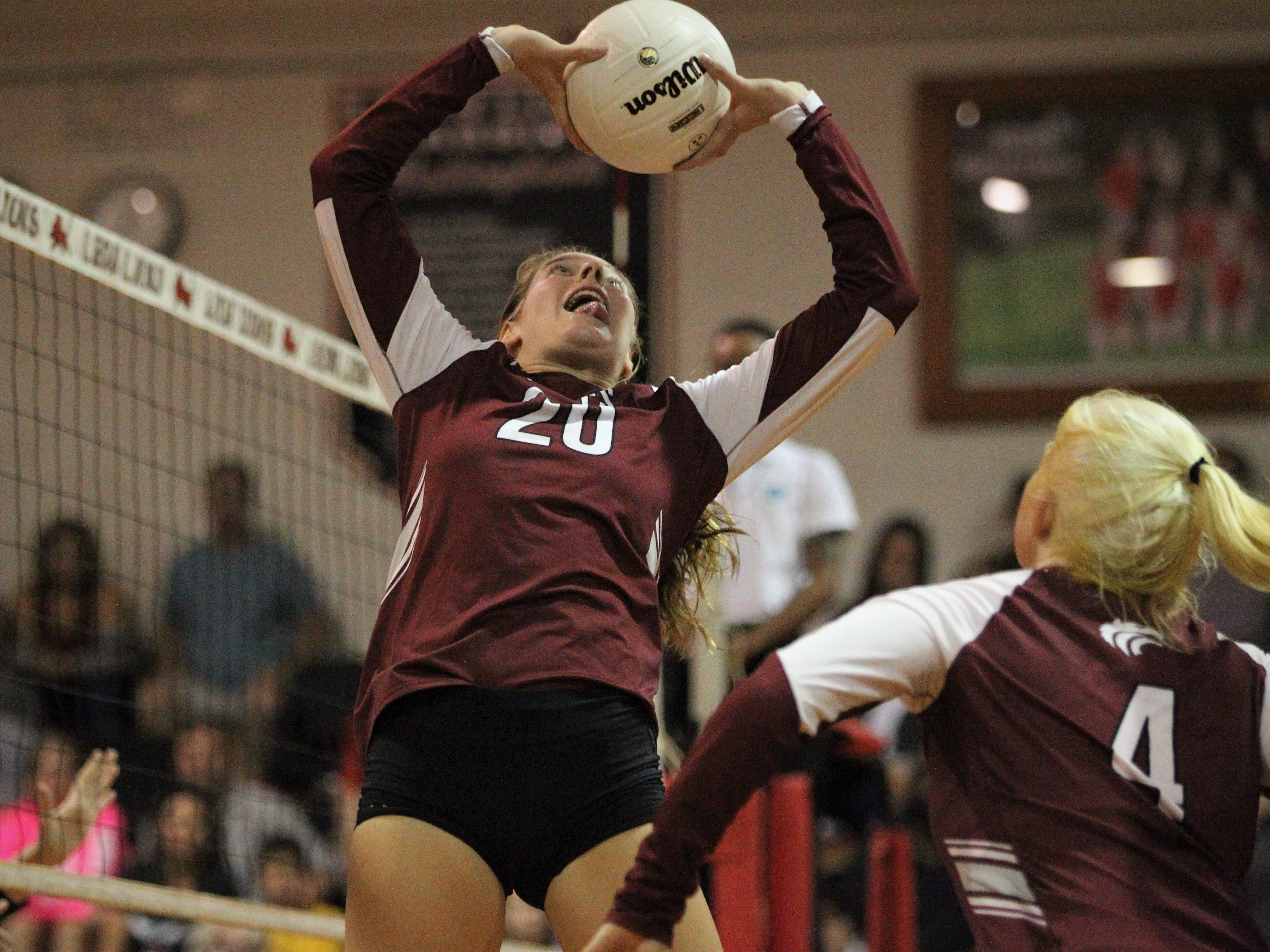 Chiles senior Kelsey Mead sets a ball during a District 2-8A championship game.