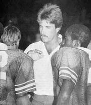 Vero Beach assistant football coach Doug Baker instructs members of the state championship team in the 1981 photo. Baker was one of four future head coaches on the coaching staff that season.