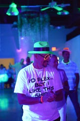 Gil Lima on the dance floor at the Glow Dance Party at the Regal Event Hall in Port St. Lucie.