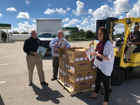 Supporters said Indian River County school Superintendent Mark Rendell supported many education programs for students. In this photo, he is seen with Michael Kint, chief executive officer of United Way of Indian River County; and Tiffany Justice, a member of the Indian River County School Board, packing children's books they sent to the Panhandle, where Hurricane Michael's impact forced schools to close.