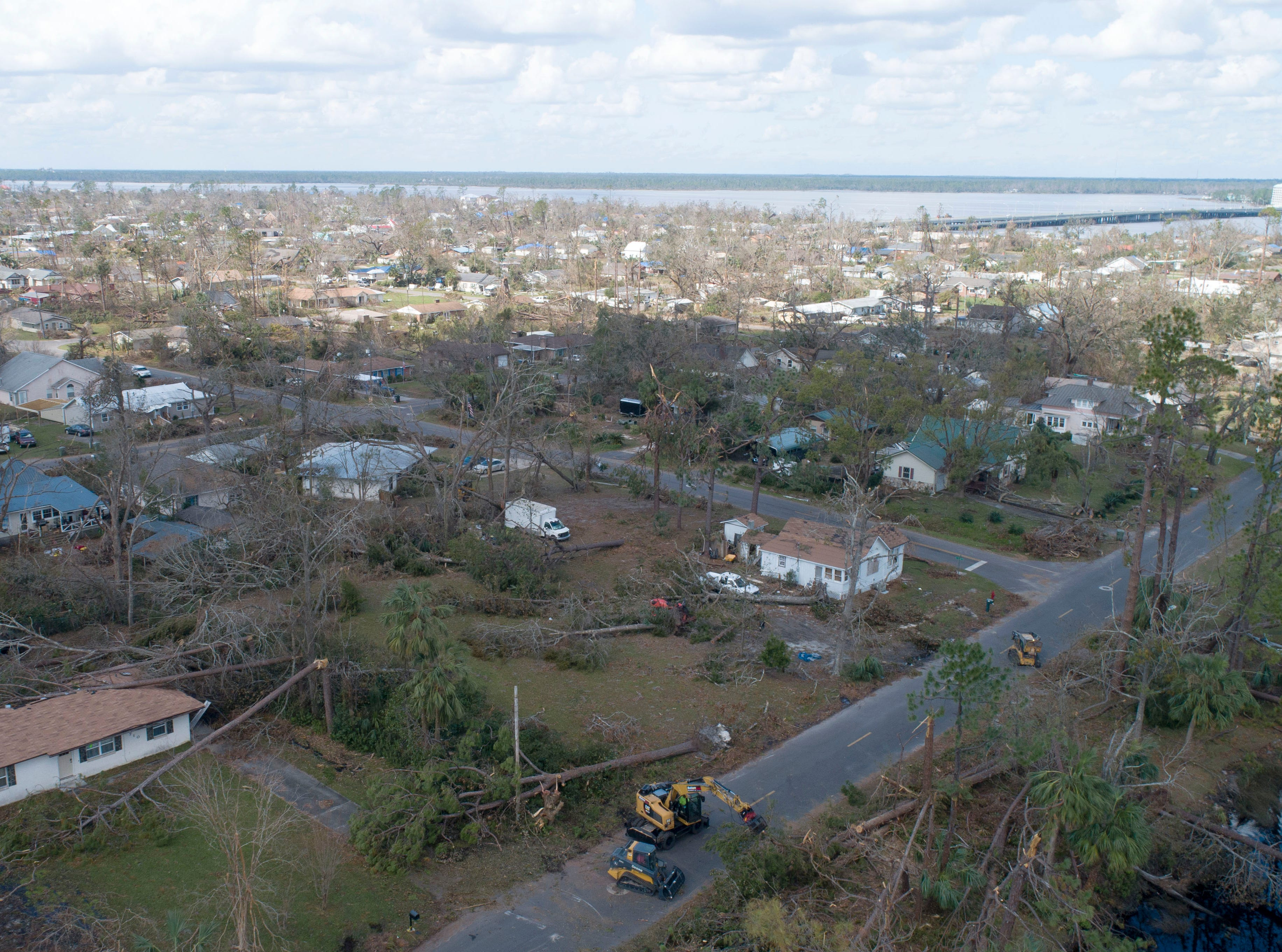 The city of Lynn Haven, Florida, works to recover Wednesday, Oct. 17, 2018, from Hurricane Michael, which made landfall in Florida's Panhandle.
