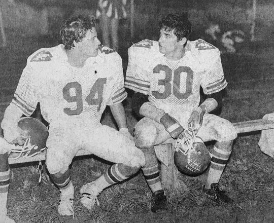 Bob Toomey (30), who played linebacker for the Fighting Indians, shares down time in the 1981 photo with defensive tackle Mark Reisman. Toomey recovered a Panama City-Mosley fumble in the final minute of the championship game.