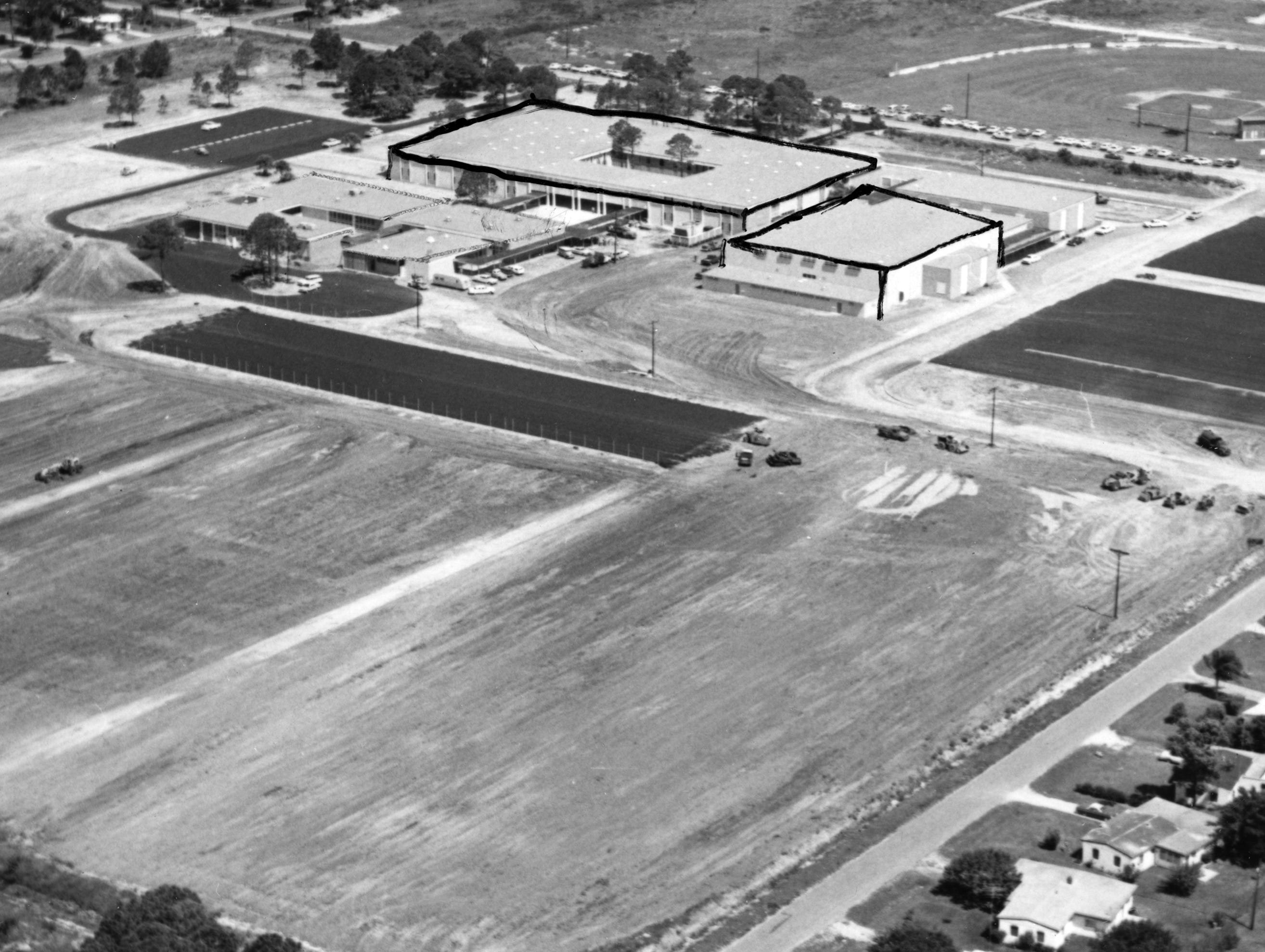 August 27, 1964 - Paved parking areas are being provided at the new Vero Beach Senior High School for more than 400 automobiles. Asphalt parking areas at right of the picture, east of the school, will accommodate more than 300 student automobiles. The paved area west of the building, plus other smaller ones, will be available for more than 100 automobiles of staff and faculty. Entrance to the school will be from 16th Street and exit will be to 16th Avenue. Both entrance and exit will be one way. The large paved area south of the area will be used for eight basketball courts and either tennis courts plus badminton and volleyball areas.
