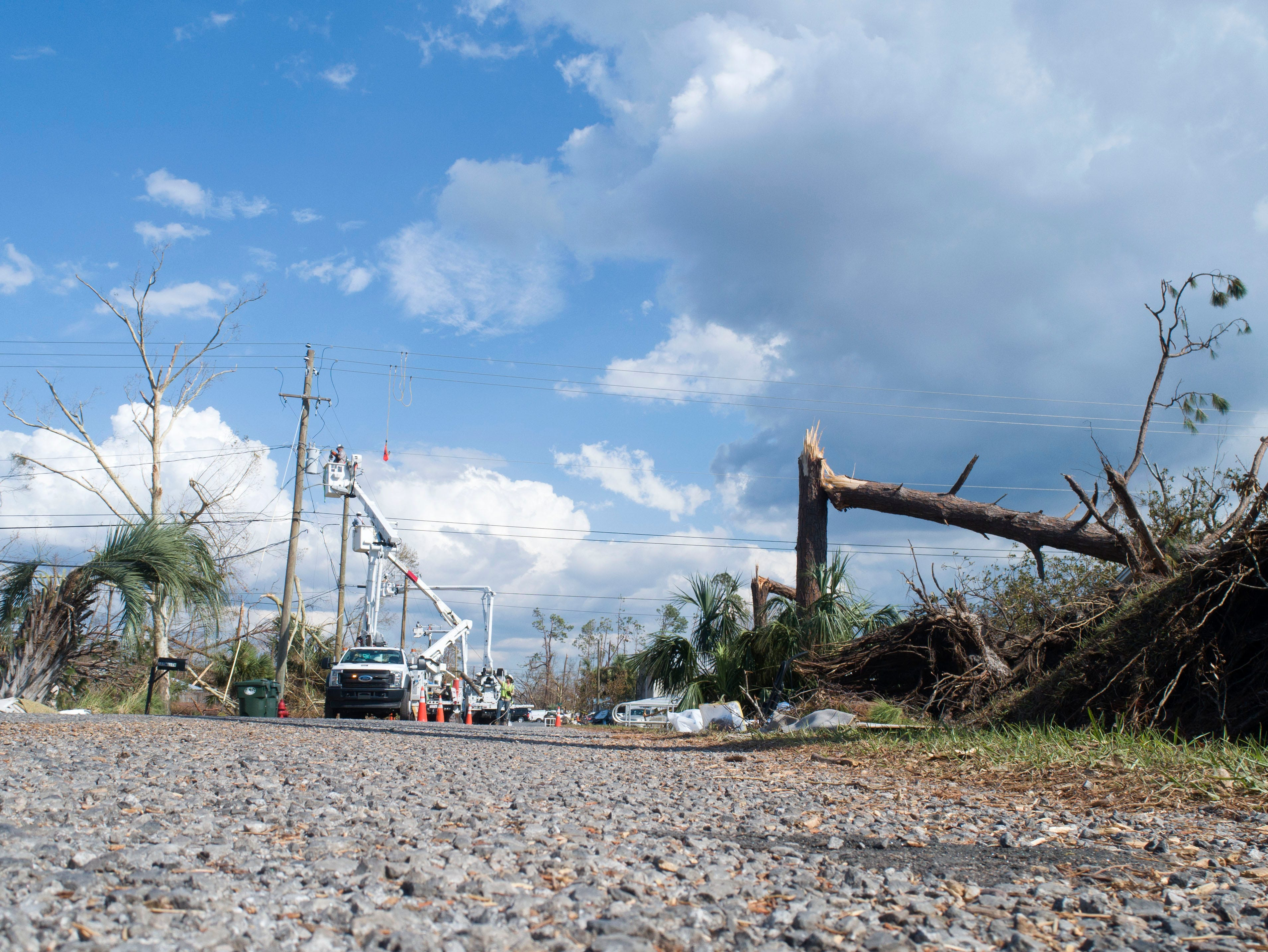 Crews work to restore power to residents of Lynn Haven one week after Hurricane Michael made landfall in Florida's Panhandle.