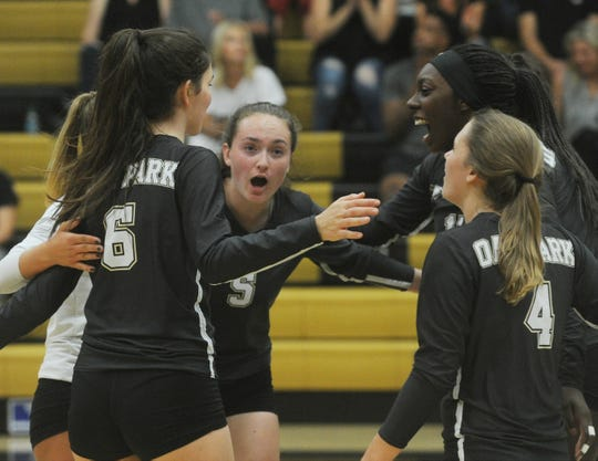 Oak Park players celebrate a point against Oxnard in a Division 4 first-round playoff match at Oak Park High on Thursday. Oak Park won in four games, 23-25, 26-24, 25-21, 25-17.