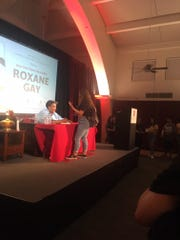 Author Roxane Gay signs copies of her book and talks to people who attended her Thursday appearance at CSU Channel Islands.