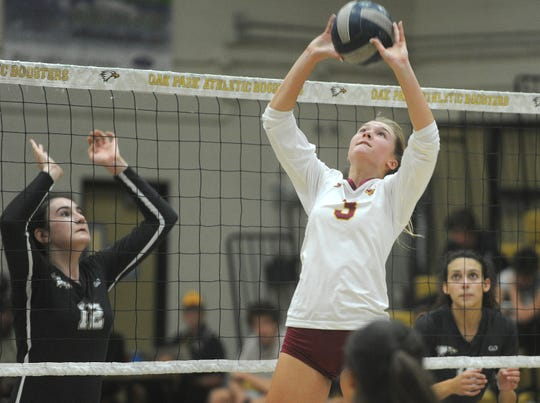Oxnard's Tess Holbert (3) sets the ball as Oak Park's Charlize Shields, left, looks on during a Division 4 first-round match Thursday night at Oak Park High. Oak Park won in four games.