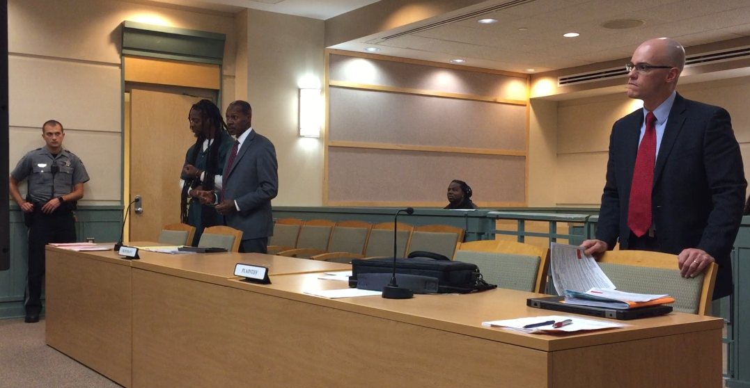 Malaga resident Eugene Cosby (left, handcuffed) stands with defense attorney Wayne Powell during a brief appearance on Friday in Cumberland County Superior Court. Cosby is one of two men charged with murder and conspiracy to commit murder. County Assistant Prosecutor Charles Wettstein (right) represents the state.