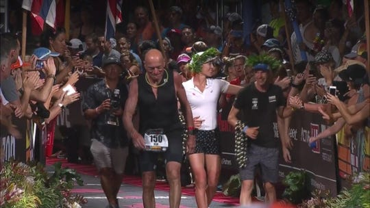 Millville's Ken Pagliughi, left, received his finisher's wreath along with the women's overall winner Daniella Ryf and men's overall winner Patrick Lange at the Ironman World Championships in Kailua-Kona, Hawaii